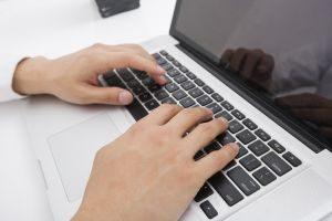 Businessman's hands using laptop